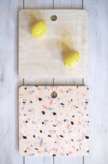 A square terrazzo cutting board by Emanuela Carratoni.