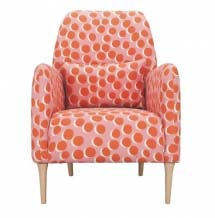 Peachy with red spots armchair.