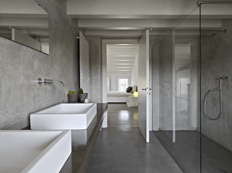 modern batroom with glass shower cubicle. microcement has been applied on the bathroom counter and walls