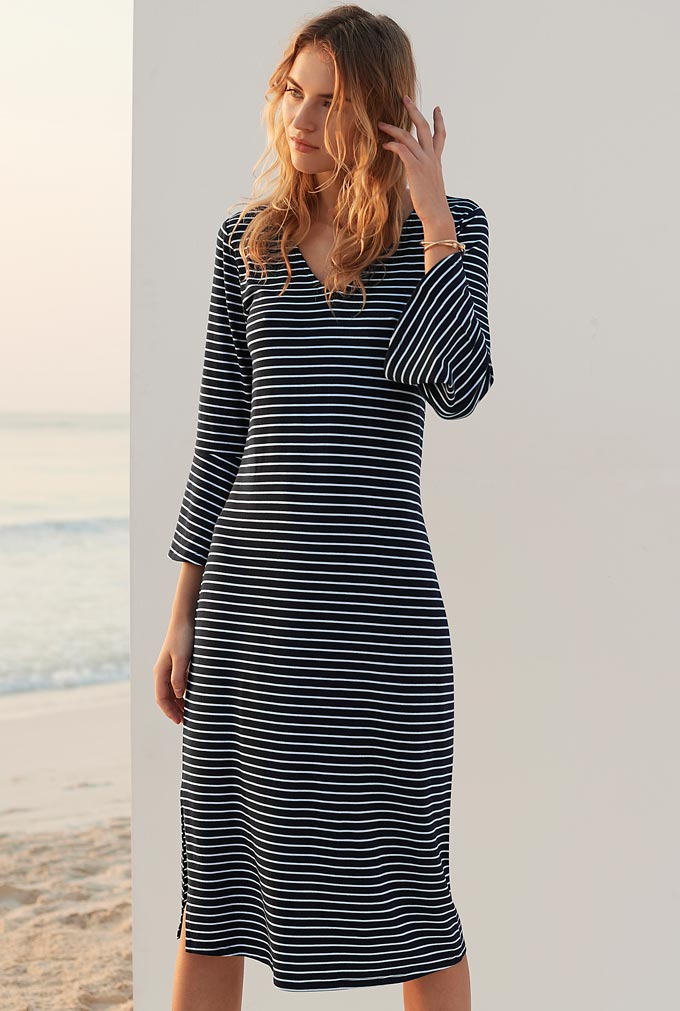 A young beautiful model is wearing a Breton styled midi flute dress and looks gorgeous in it. Image by Long Tall Sally.
