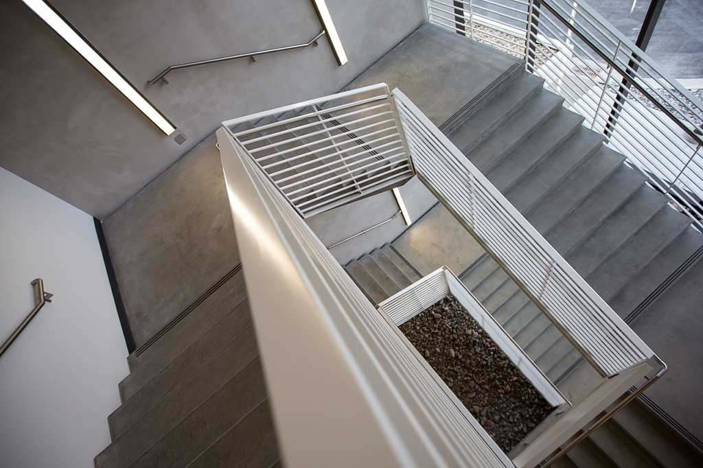 View of an interior stairwell in a building with microcement stairs
