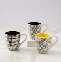Mugs with various black geometric patterns against a white background. The inside of the mug comes in various colors.