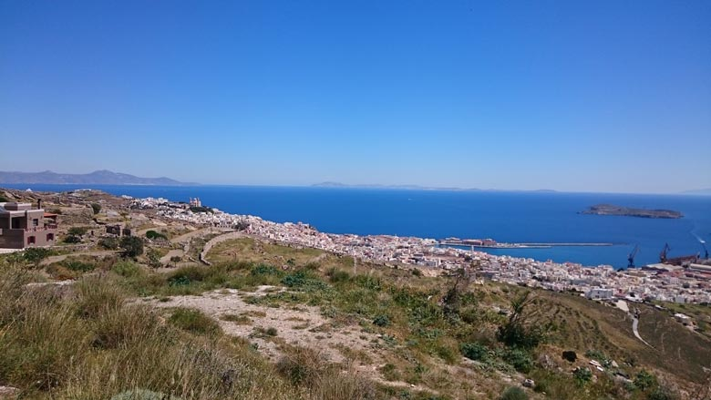 Bird's eye view of the town of Hermoupolis with the port from afar.