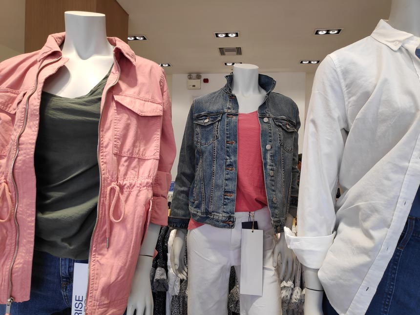 Mannequins dressed in casual outfits in a store.