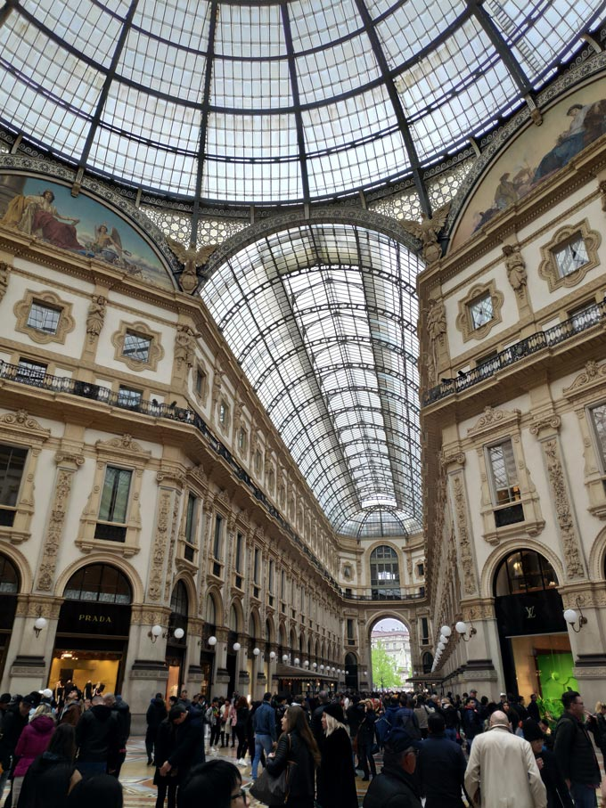 Lots of people inside a shopping arcade in Milan. Image by Velvet.