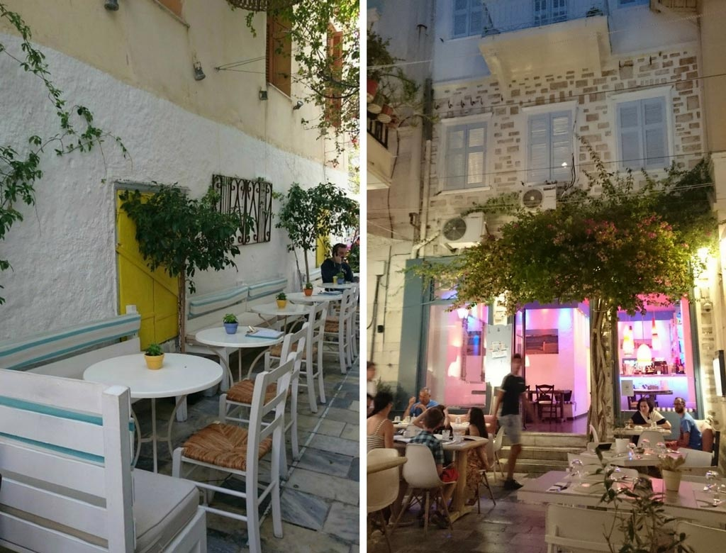 Left: White outdoor seating in a narrow alley belonging to a small cafe. Right: An old stone building with a restaurant called Kouzina at the ground level, with colorful lit lights.