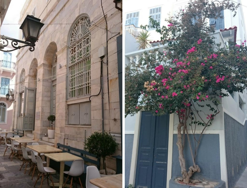 Left: An old stone building next to Kouzina restaurant with outdoor seating in front of it. Right: A renovated gray-blue house.