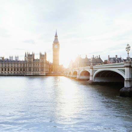 London's Big Ben and parliament house with the crossing bridge. Image taken from the south bank.