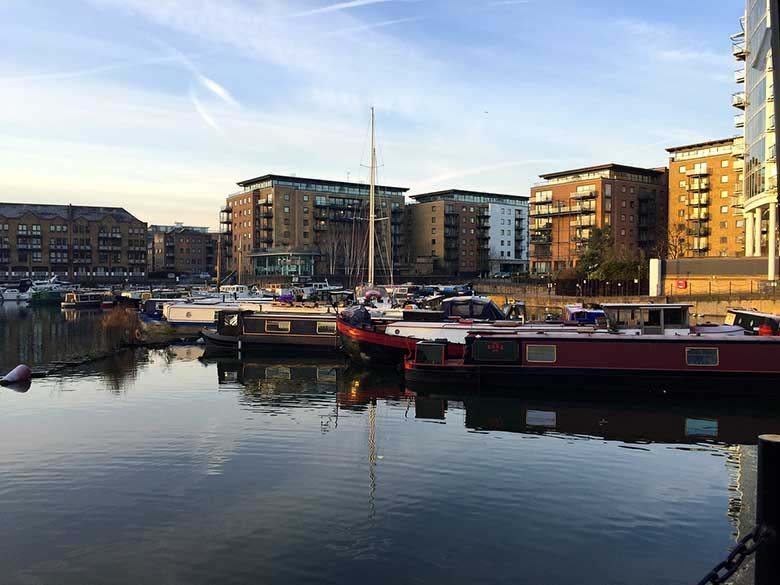 View of part of Docklands with some housing buildings in the background and a mooring dock in the foreground