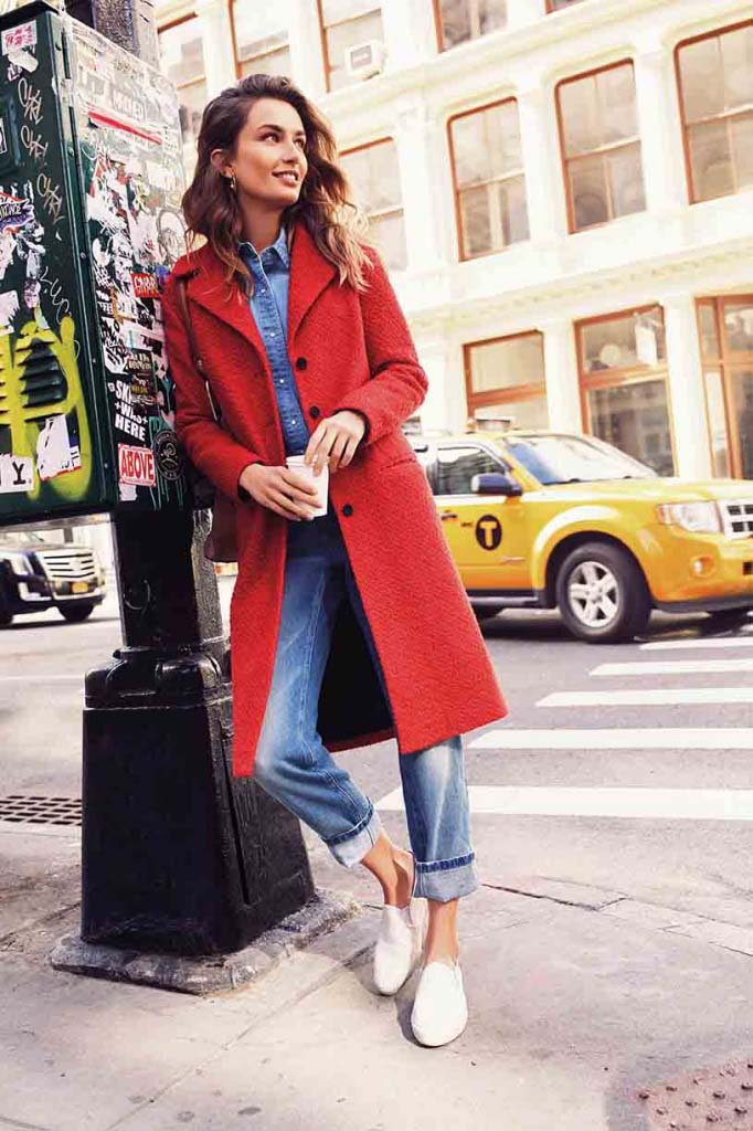 A stunning red coat over a jeans outfit and white sneakers always looks spot on. Image by nextplc.co.uk
