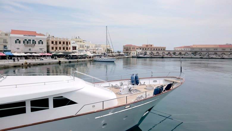 Partial view of the port in Syros. A yacht is also seen.