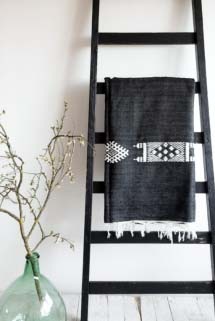 Black throw with a geometric tribal pattern