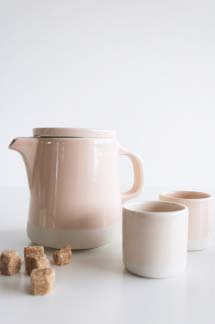 Pale pink teapot with two goblets