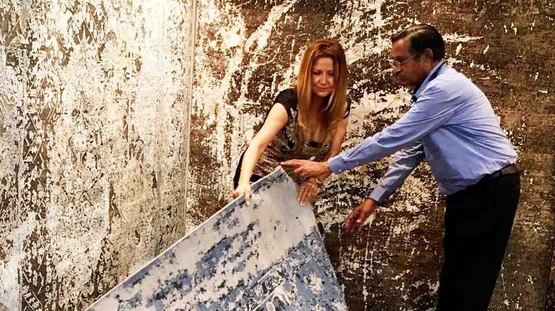 Argyriou with a man while sampling carpets