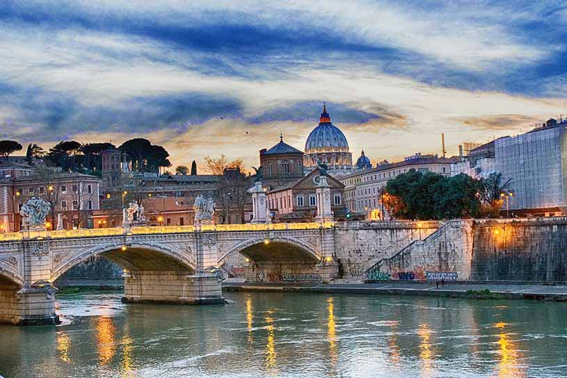 View of the Tiber river in Rome and St. Peters Cathedral in the background in Rome