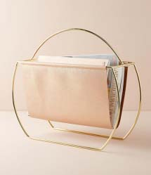 Magazine rack with brass frame and blush pink holder
