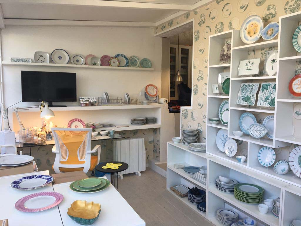 The studio where all the creativity takes place. Shelves showcase the products (tableware)