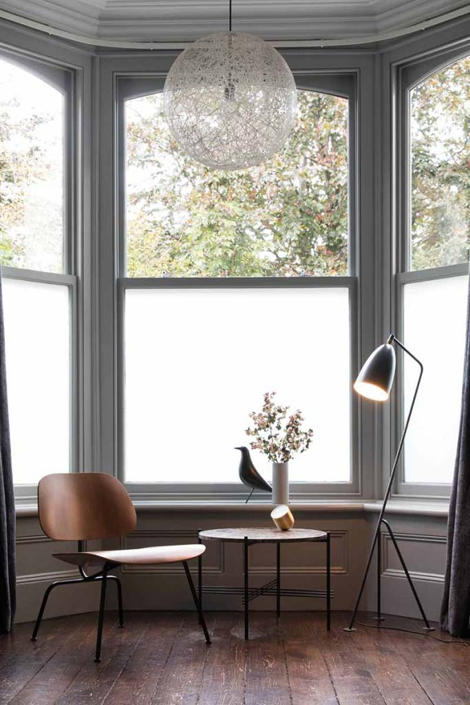 The Vitra LCM Eames Plywood Lounge Chair looking good in its simplicity by a bay window. A side table and a floor lamp is all it needs to showcase its natural beauty. Image by Nest.co.uk