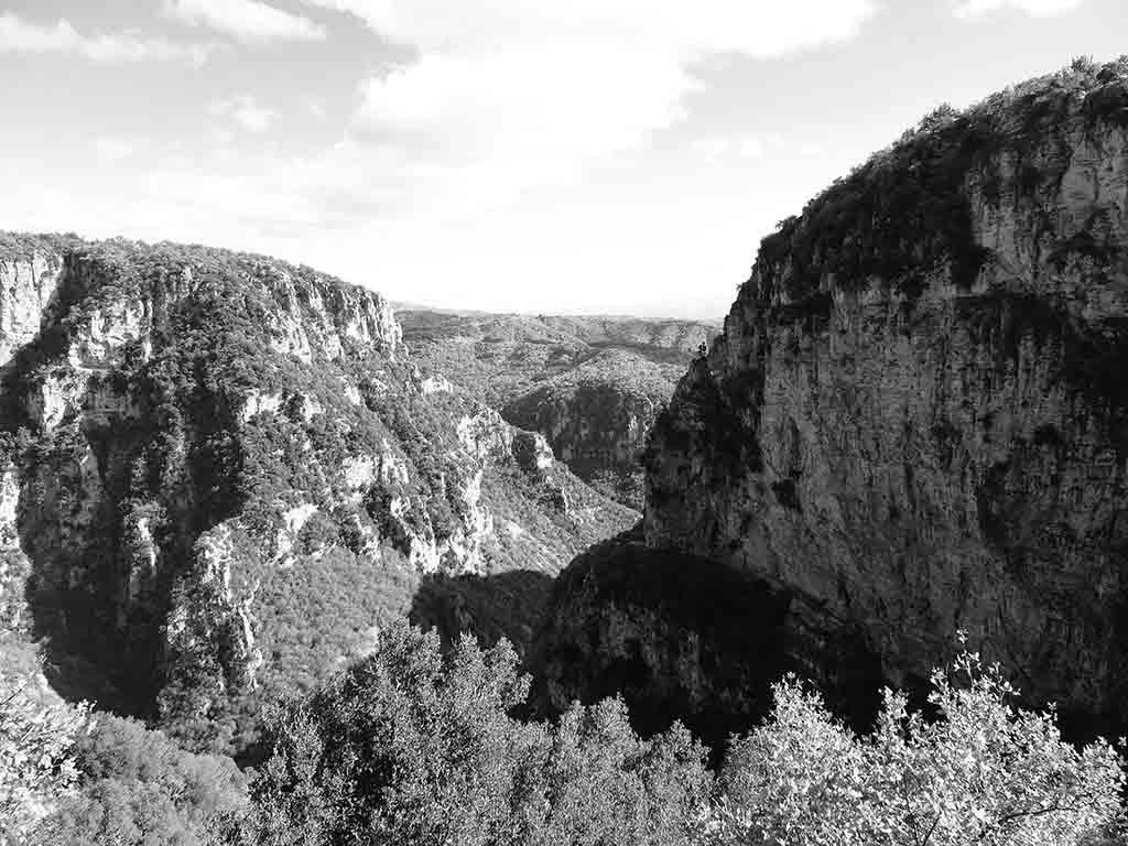 A black and white image of the Vikos Gorge.