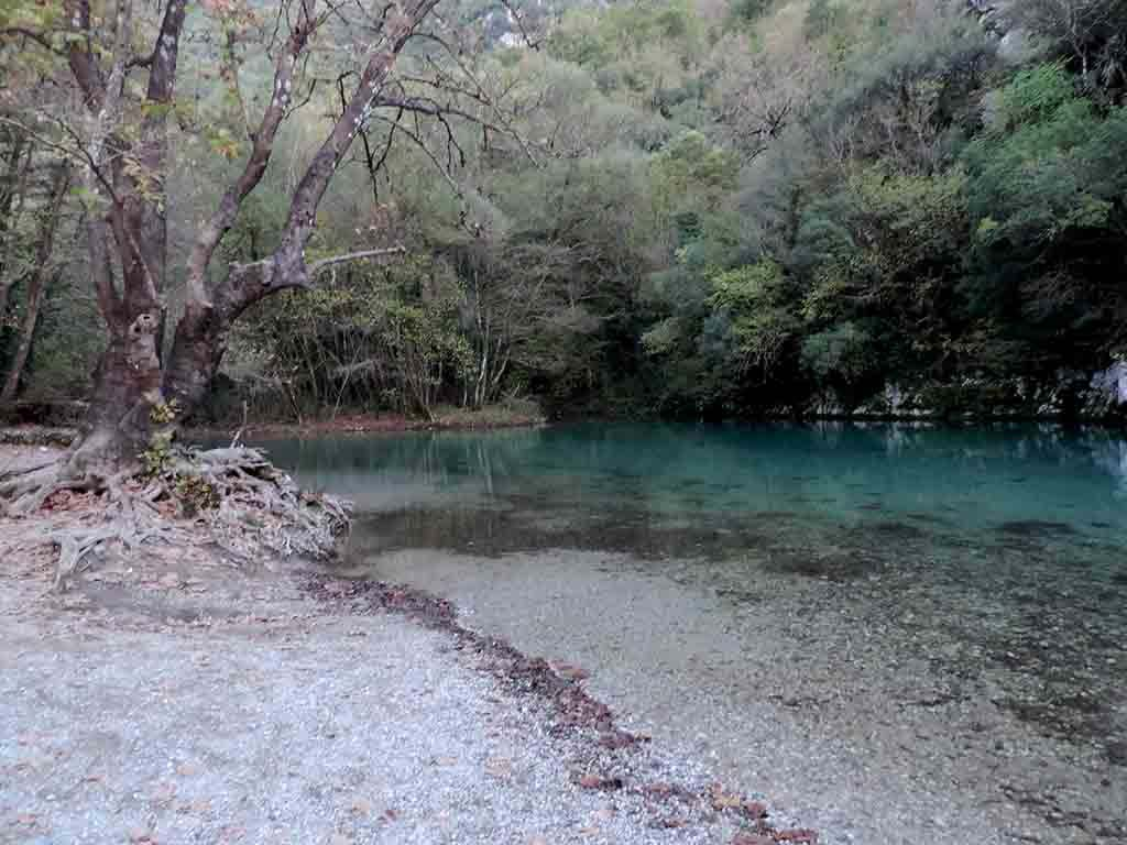 View of the clear blue river waters of the Voidomatis River