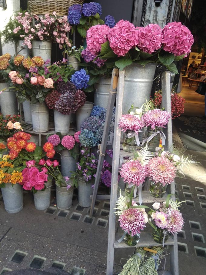 Flower bouquets for sale outside of flower shop in West End London.