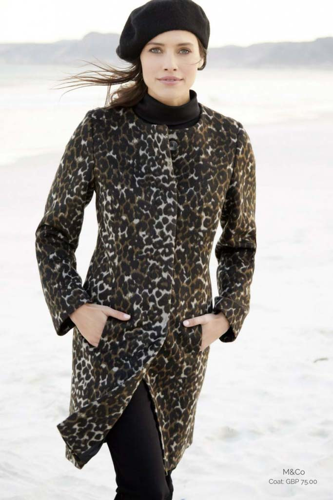 That's the perfect way to wear a all black outfit when paired with a leopard print coat and a black beret just like the beautiful model in the image. Image by M&Co.