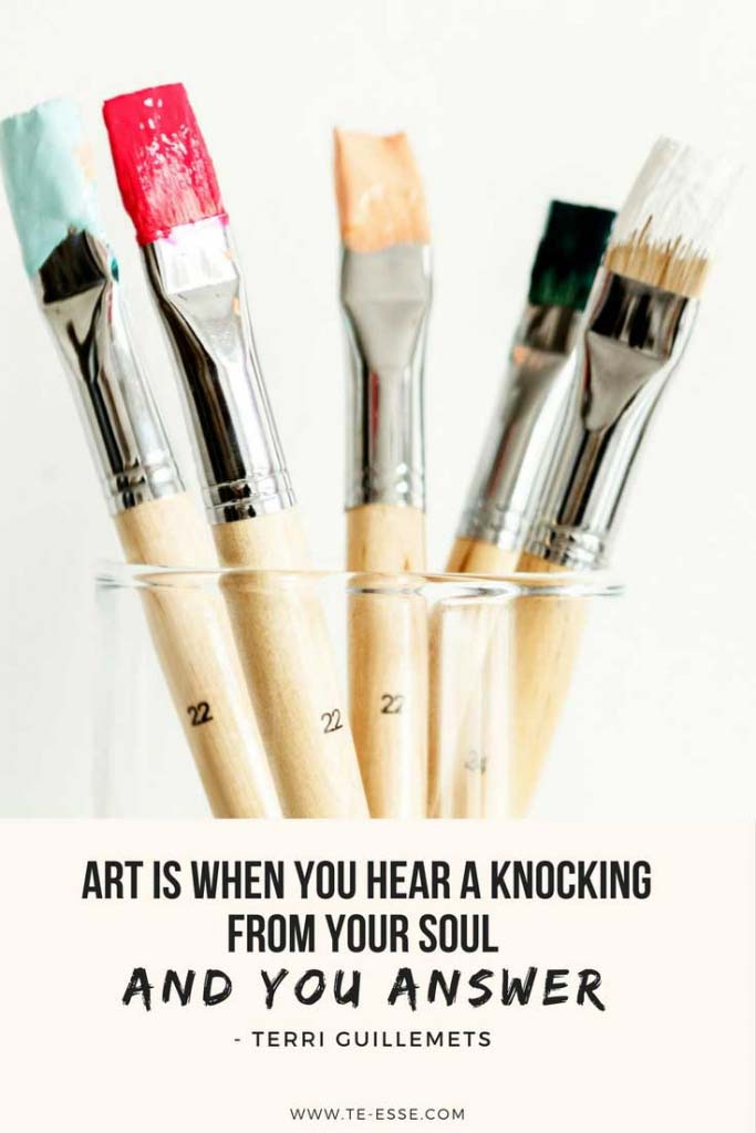 A photo from rawpixel of paint brushes in a glass beaker. The quote reads Art is when you hear a knocking from your soul and you answer cited from Terri Guillemets.