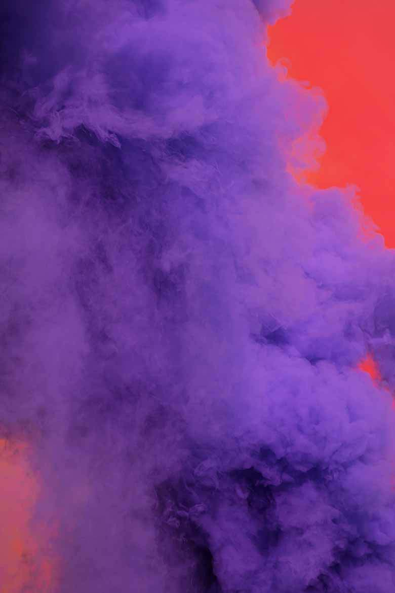 Purple smoke going up against a red background