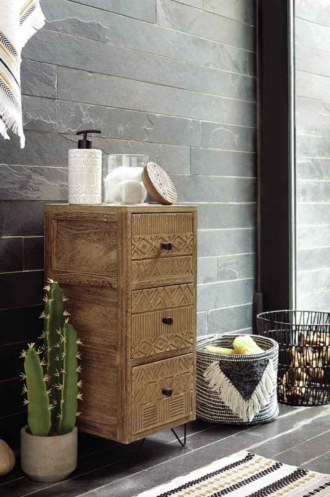 The geometric pattern on the drawers surely add an element of interest. Add on the geometrical pattern of the basket and the rug and the trend is simply nailed on in this contemporary bathroom! Image by Dunelm.