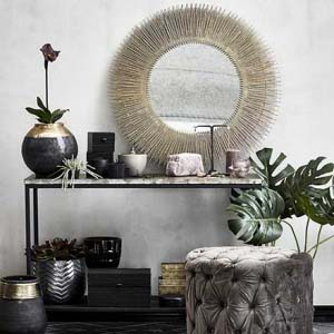 A Lene Bjerre Dessia Console Table is looking good by an entrance, styled with vases and plants and a great goldish mirror. Image by Houseology.