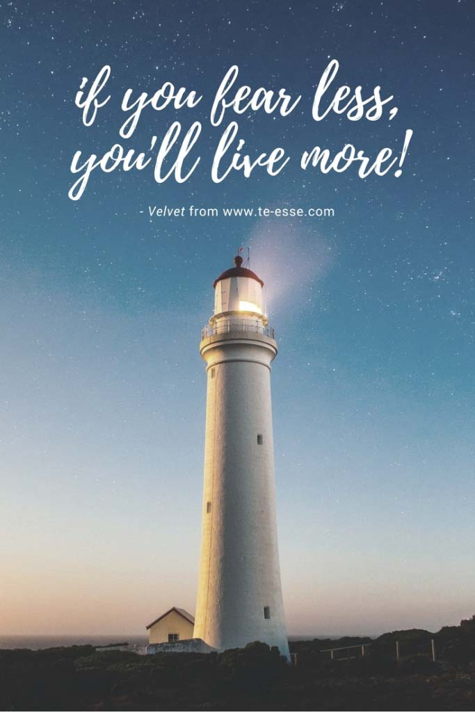 A great shot of a lighthouse just after sunset with a quote atop reading If you fear less, you'll live more cited from Velvet