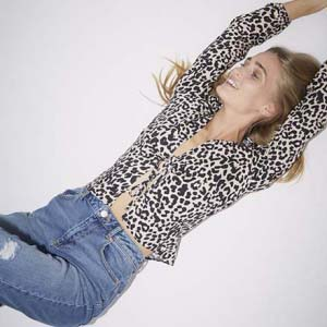A leopard print shirt is always a good idea, just like the one worn by a young blonde model for Miss Selfridge.