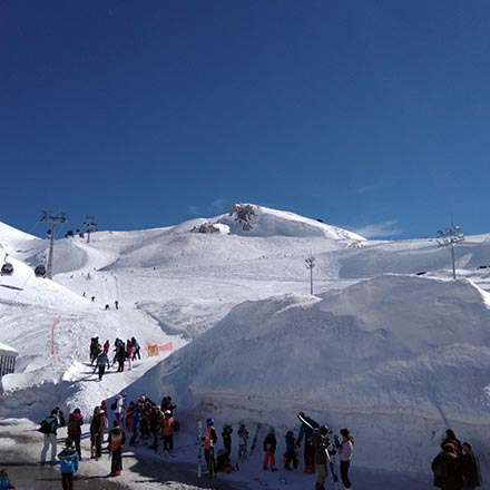 Partial view of Parnassos ski slopes on a sunny day.