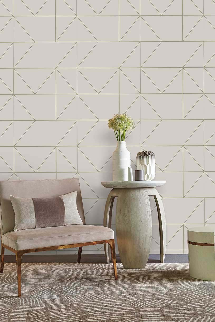 A soft blush colored wallpaper with a geometric motif. Simply gorgeous. Image by Homebase.