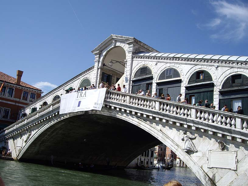 A closer view of the famous ornate Rialto Bridge in Venice spanning over the Grand Canal.