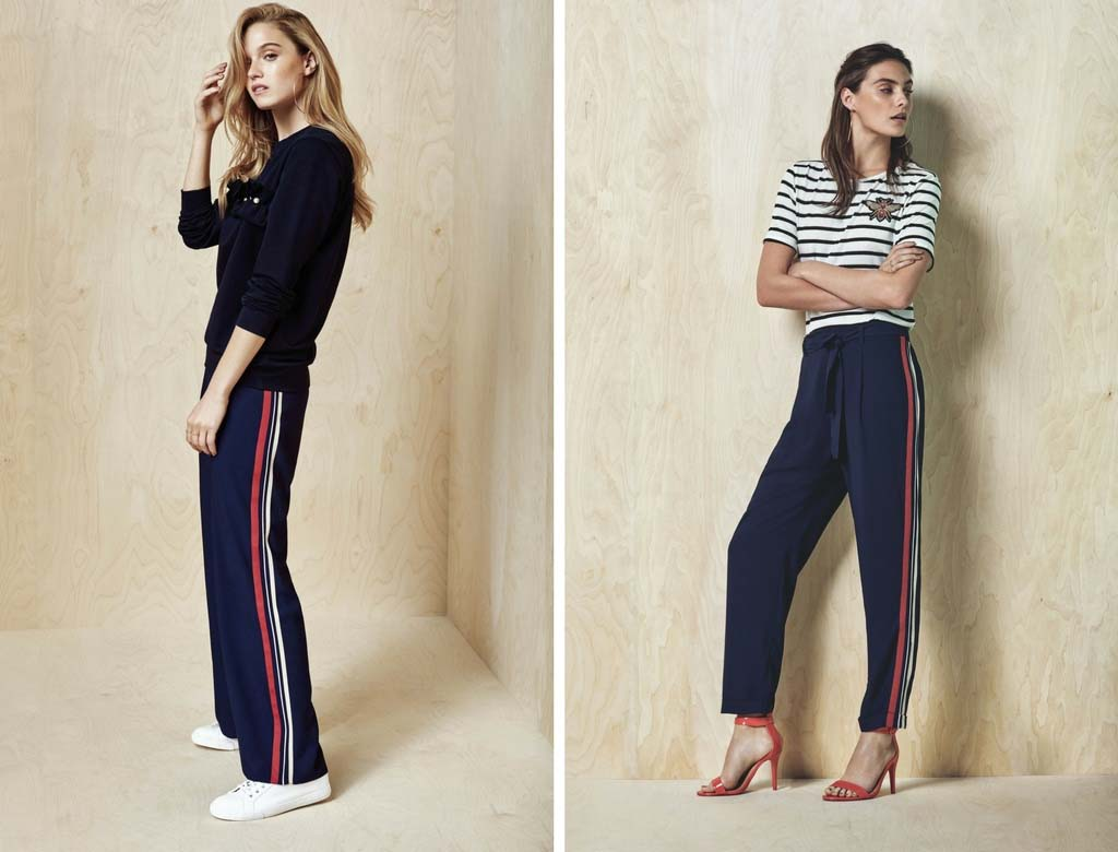 Track pants worn with white trainers and sweat top can look just as fashionable when worn with red high heel sandals and a Breton top, as seen in these two models. Images by Dorothy Perkins.