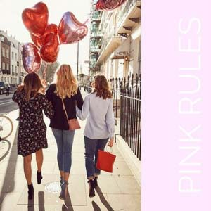 The girls-friends walking down the street with heart-shaped balloons celebrating Galentines. Image by Dorothy Perkins.