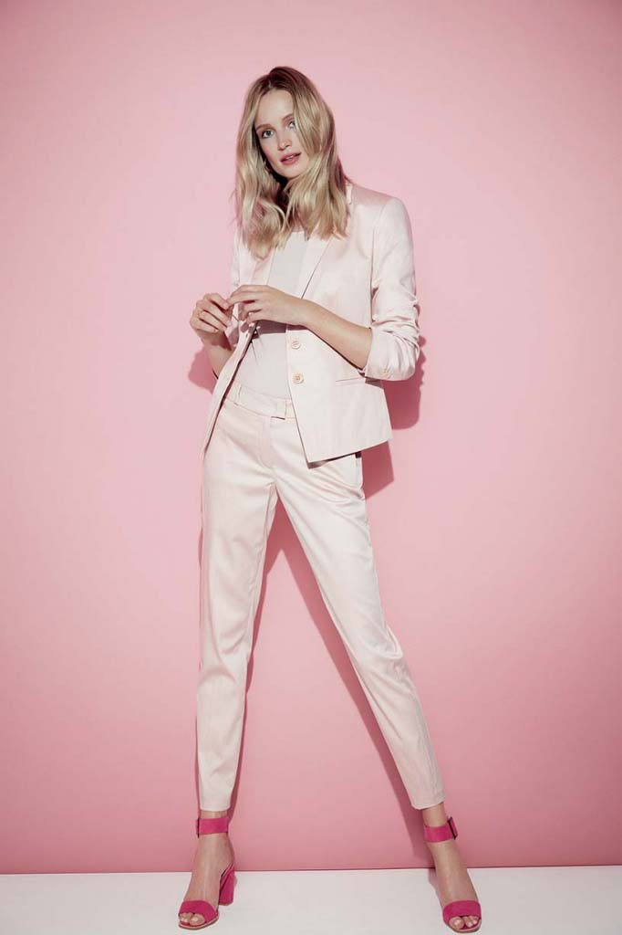 What a super cool pink power suit, combined with hot pink high heel sandals. Image by Betty and Co.