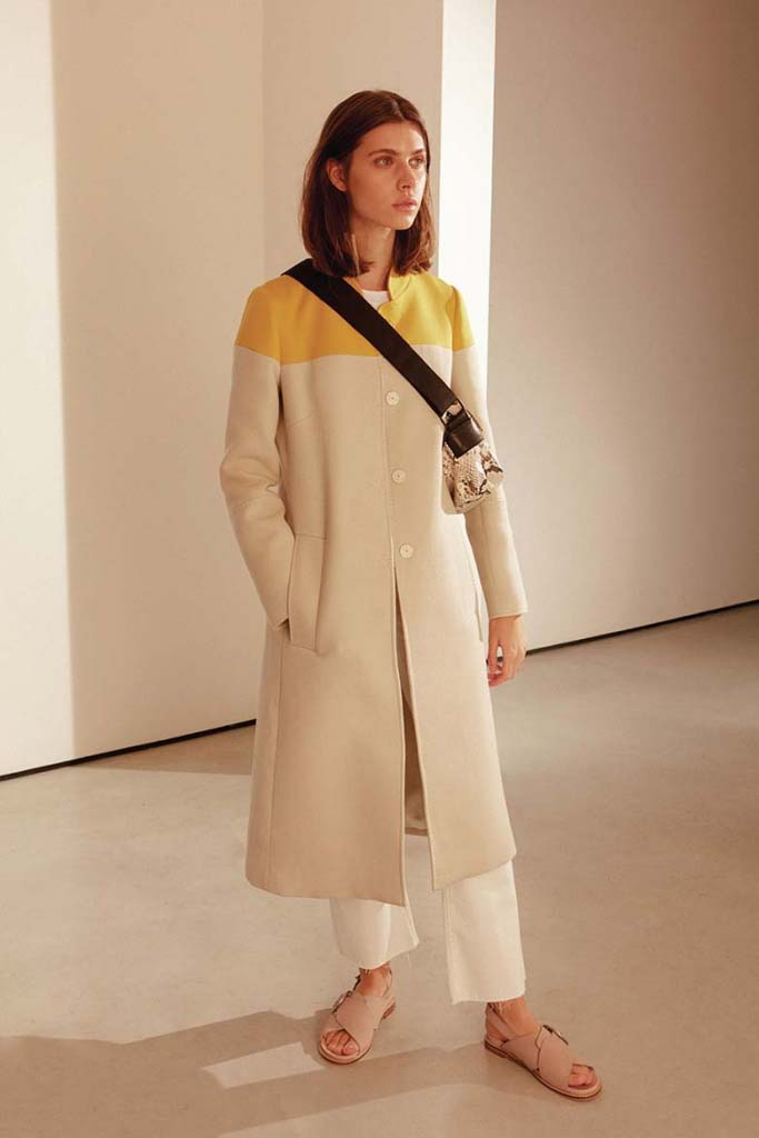A beautiful color blocked beige with yellow trench coat, worn by a young model. Image by Jigsaw.