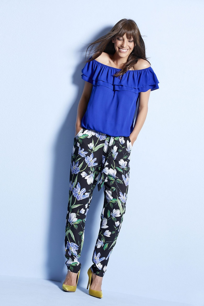 A eye catching cobalt blue Bardot top combined with tailored pants with a floral print can look great. Image by M&Co.