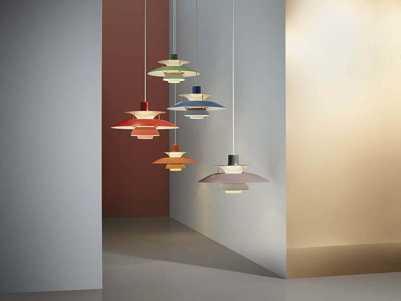 Several PH5 pendant lamps hanging in different colors. A great way to celebrate the 60th anniversary of this iconic lamp. Image by nest.co.uk