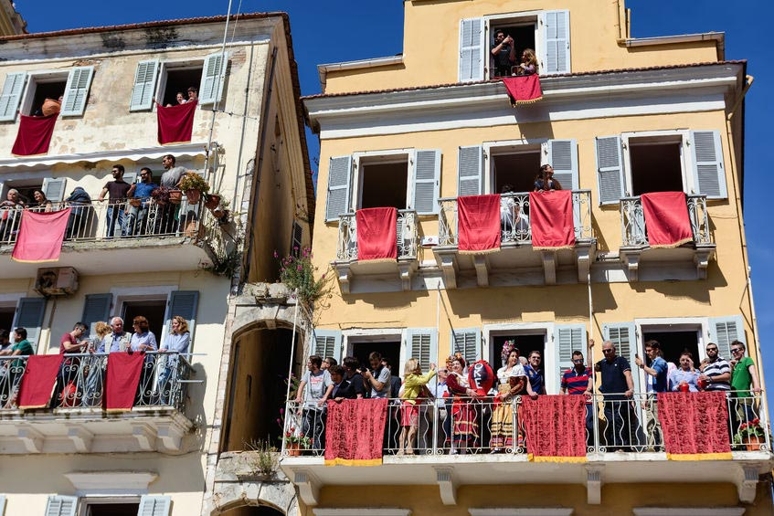 People of Corfu throwing clay pots from their home balconies and windows during Easter celebrations.