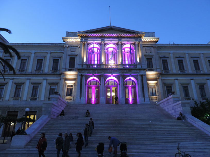The Town Hall in Ermoupoli Syros lit with mauve lighting because it's Good Friday.