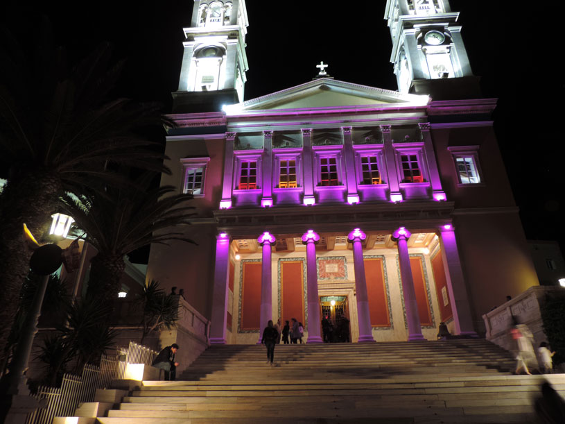 Image of the Church of Saint Nicholas in Ermoupoli Syros, with mauve lighting on Good Friday.