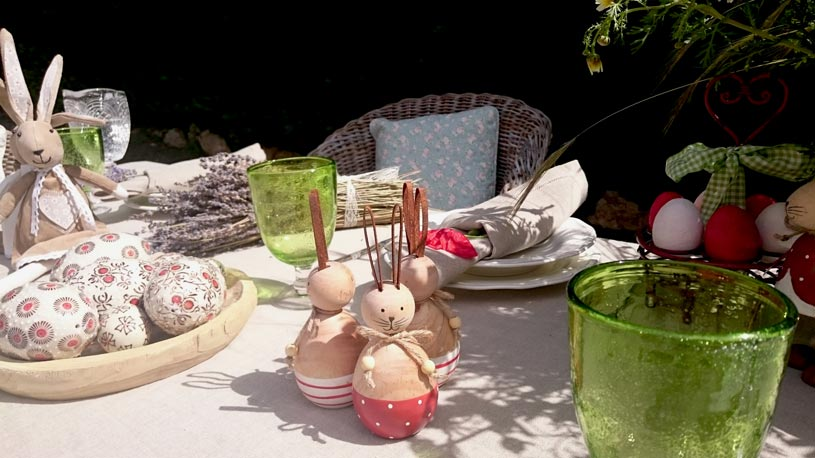 Close up of the wooden rabbits decor on the outdoor dining setup.
