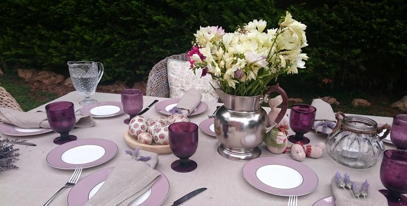 A second tablescape for Easter dining with splashes of pink and mauve accents. Close up.