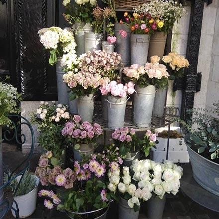 Lots of flower bouquets on sale outside a florist shop in London.