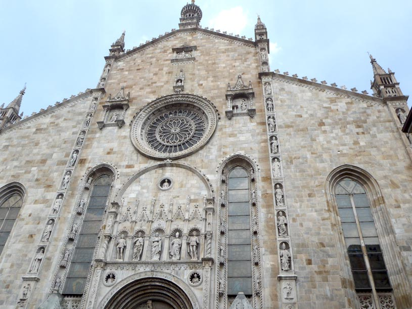 The front facade of the Duomo Cathedral in Como with its Gothic architectural elements.