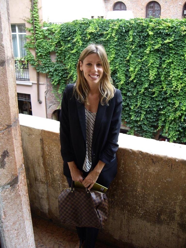 Elisabeth standing in Juliet's balcony in Verona, Italy.