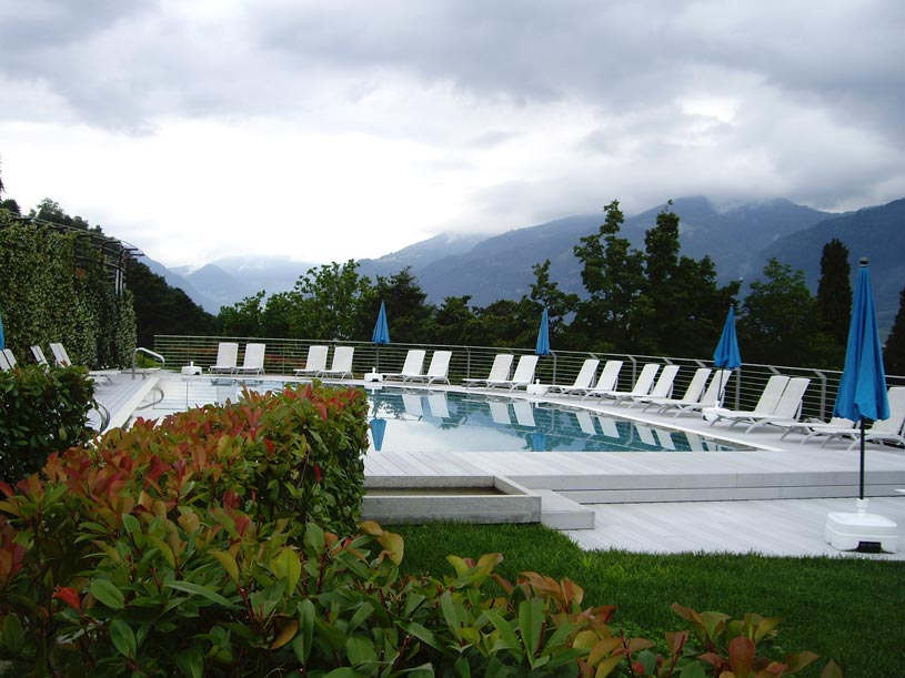 The swimming pool of our hotel with a view of the Lake Como, on a cloudy day.